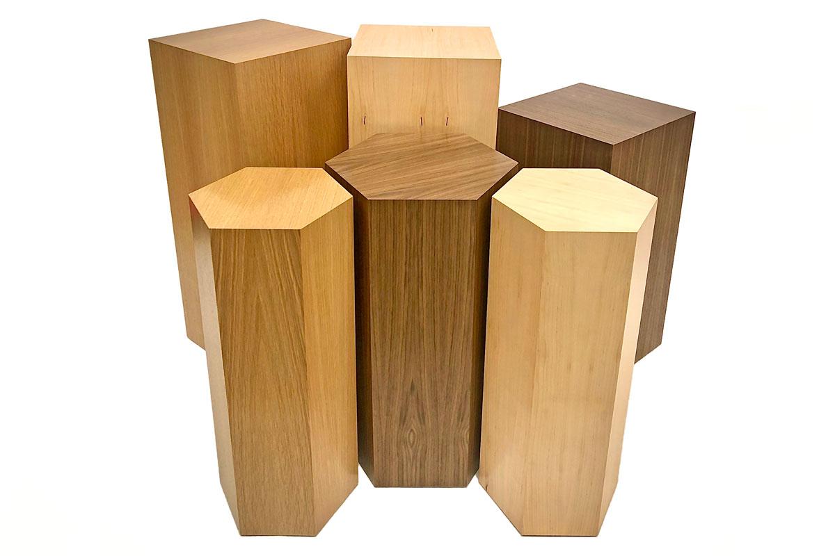 photo of a group of wood veneer plinths