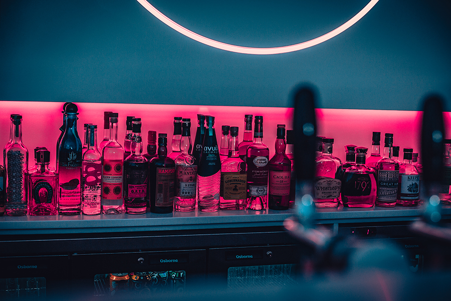 A selection of drinks behind a bar