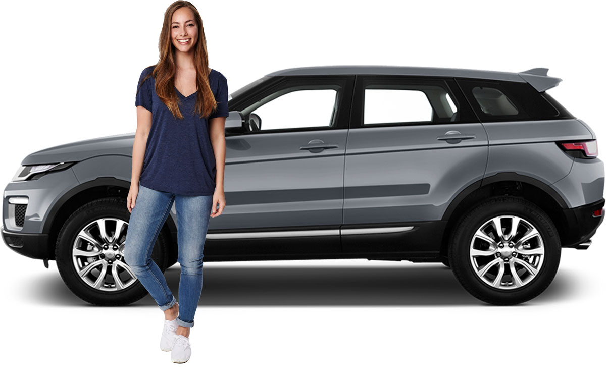 Woman standing with Range Rover Evoque