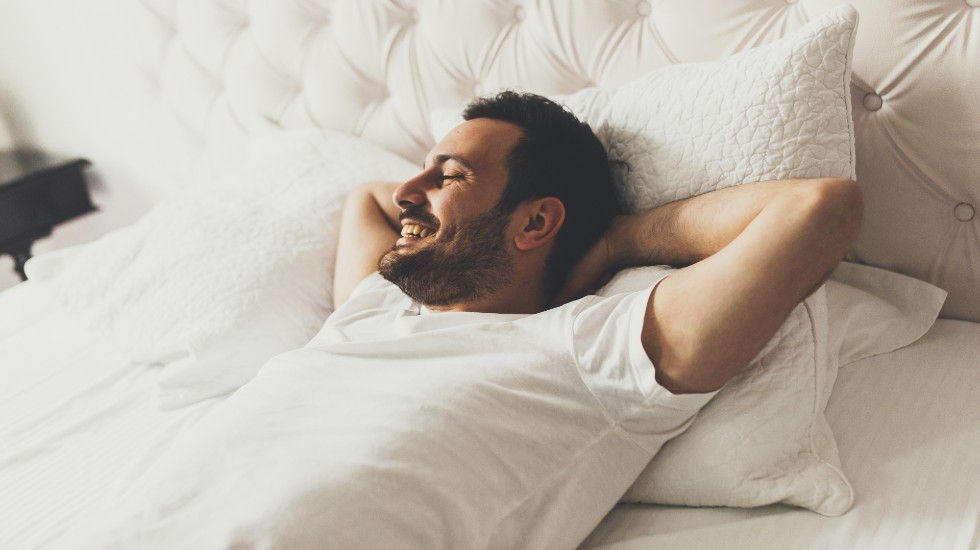 man reclining in bed during ice detox