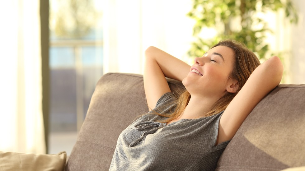 woman relaxing at home after ice rehabilitation