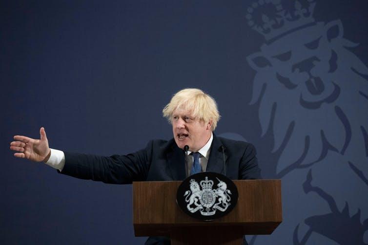 Boris Johnson making a speech at a podium