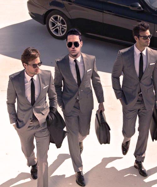 three businessmen in suits