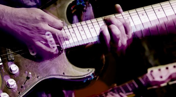 Hands playing lead guitar