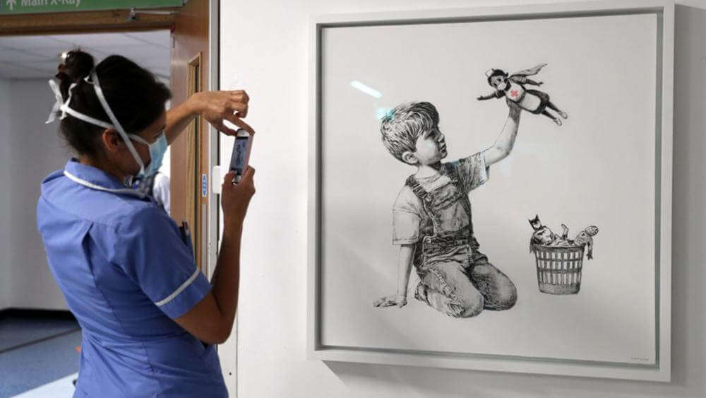 Perhaps art won't heal patients,  but Banksy has found a way to bring some comfort to doctors and nurses on the front lines through his art :      A new work by the elusive street artist Banksy, honor