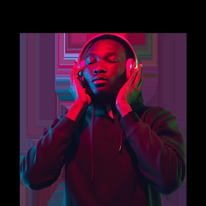 Man wearing headphones with sound waves around him