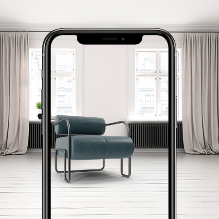 Mobile phone showing a room and a augmented reality chair