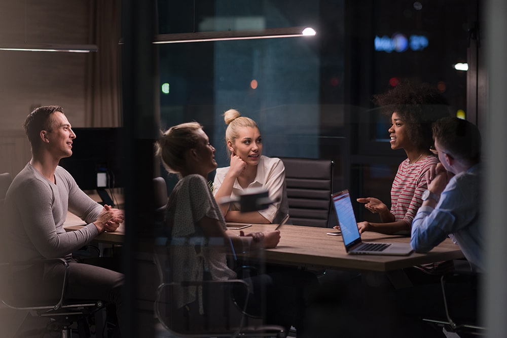 A group of people around a conference table