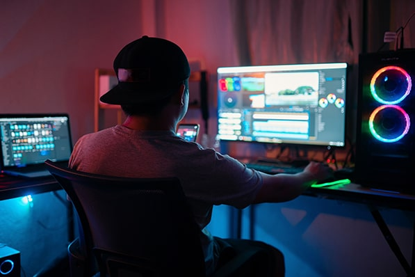 Young man using video editing software