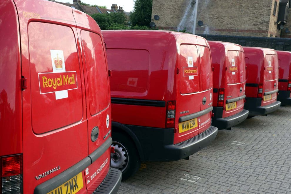 Shiny red Royal Mail vans line up at their Livingstone depo.