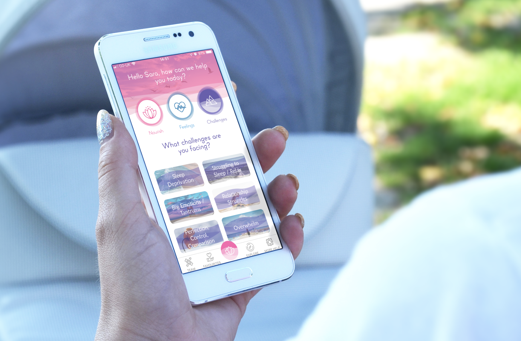 """A white smartphone shows a pink and purple themed app interface. Buttons show """"nourish, feelings, challenges"""" and the text """"Hello Sara, how can we help you today?"""""""