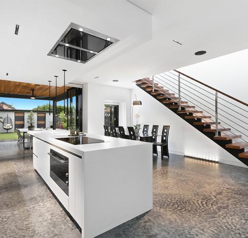 Modern white kitchen with island bench.