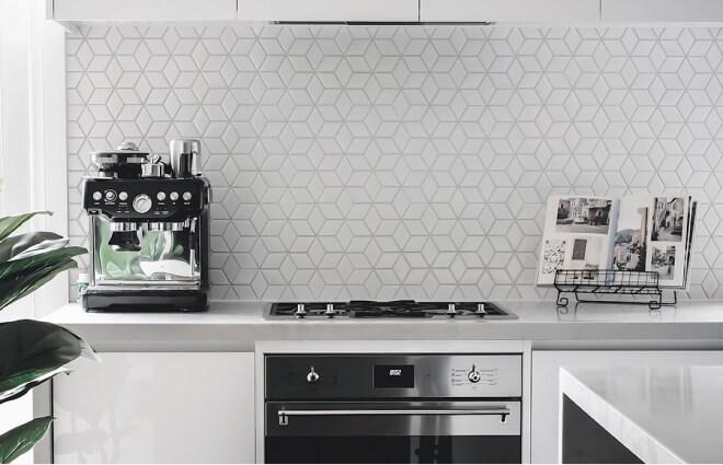 Kitchen with hexagonal tiles.