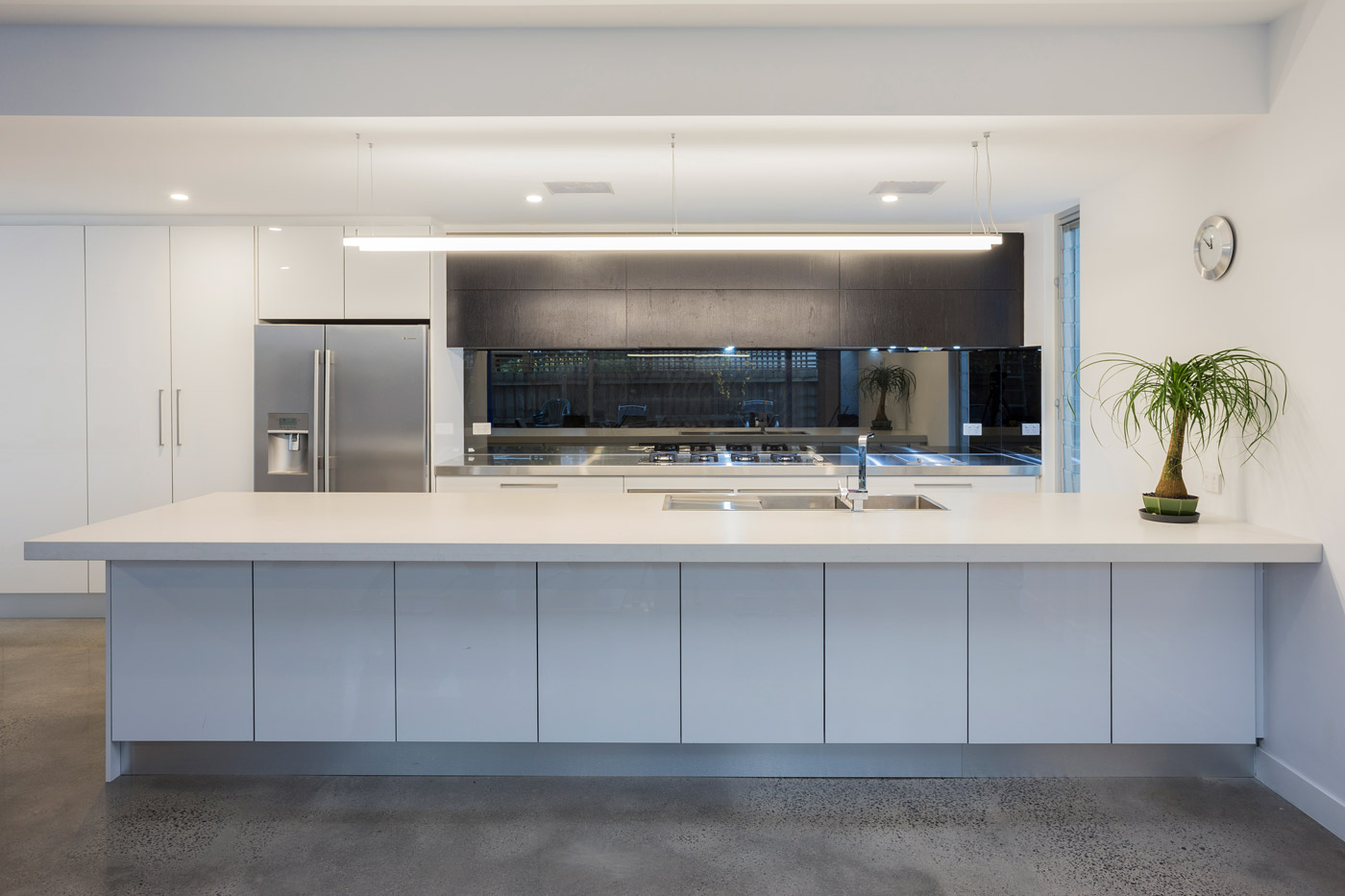 Stunning Artic ice acrylic full gloss kitchen with feature timber veneer full lift cabinets with two silent rangehoods.