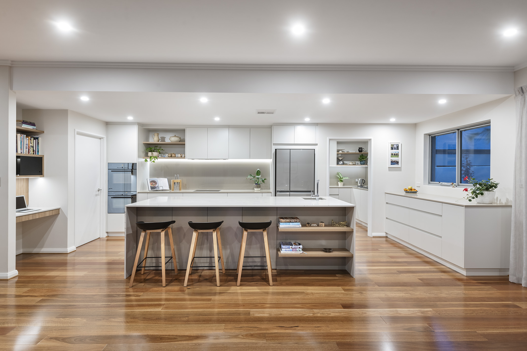 The kitchen is undoubtedly the focal point of this home; a spacious hub where warm memories are made, and family and friends can gather to share stories.