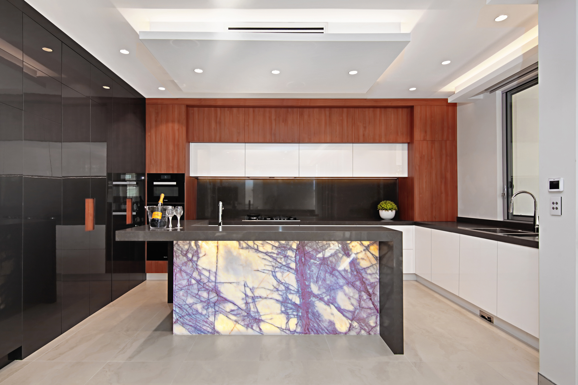 This kitchen by Impala Kitchens and Bathrooms is in a beautiful newly constructed multi-level home. The client's brief was to maintain stylistic integrity throughout this luxurious home.