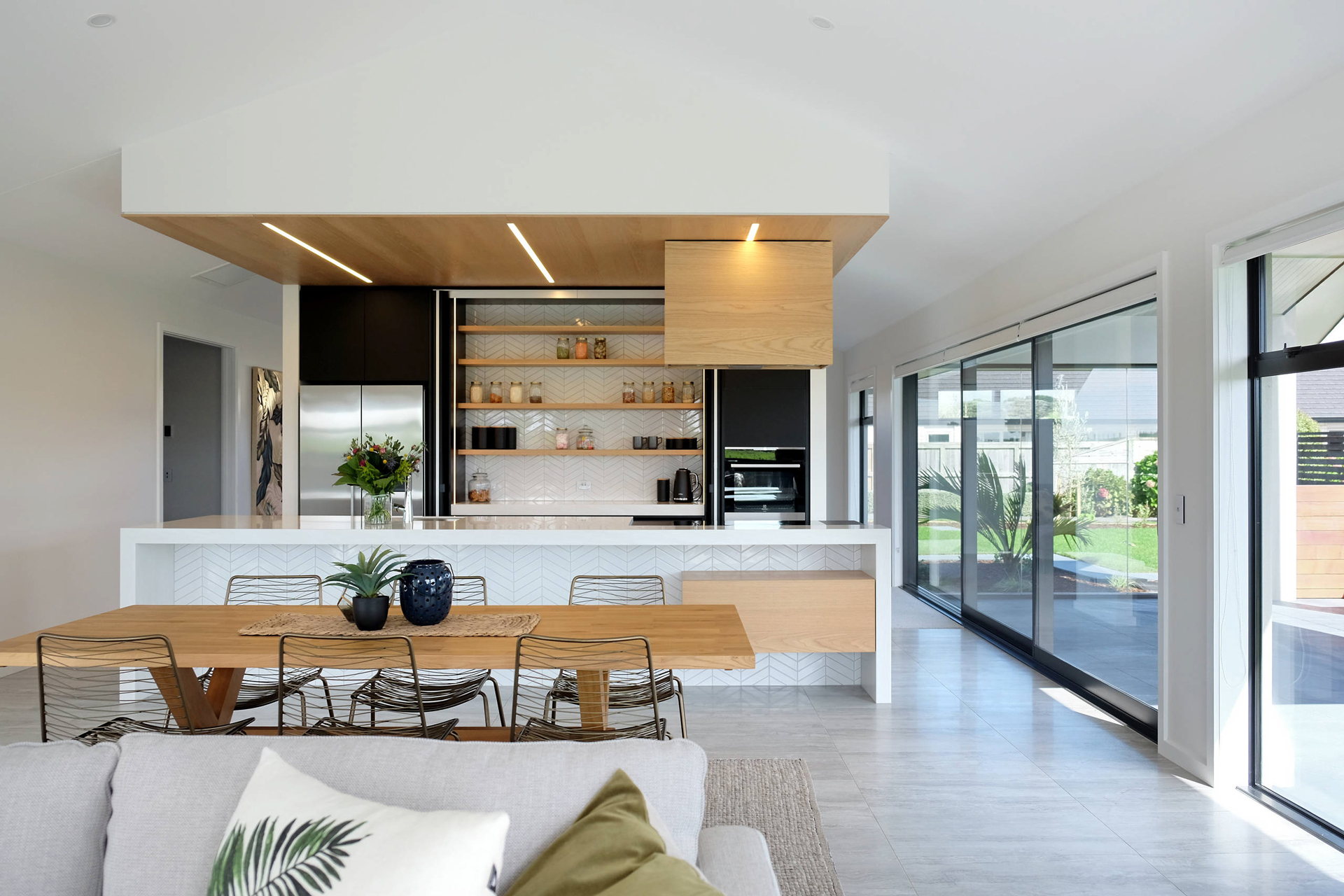 This stunning space uses a simple crisp palette to ground and defines the space beautifully.