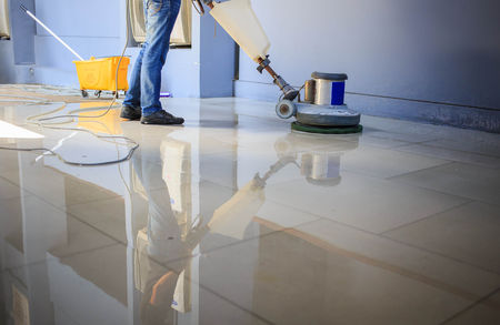 Man cleaning tile floors