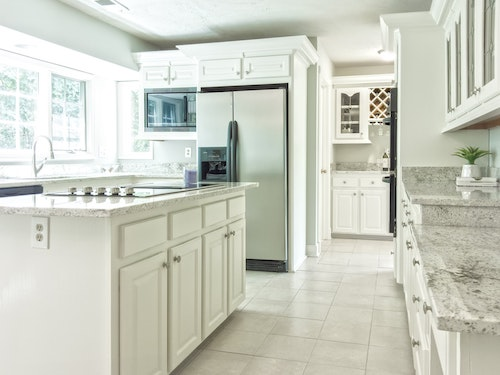 clean kitchen with clean tile floors