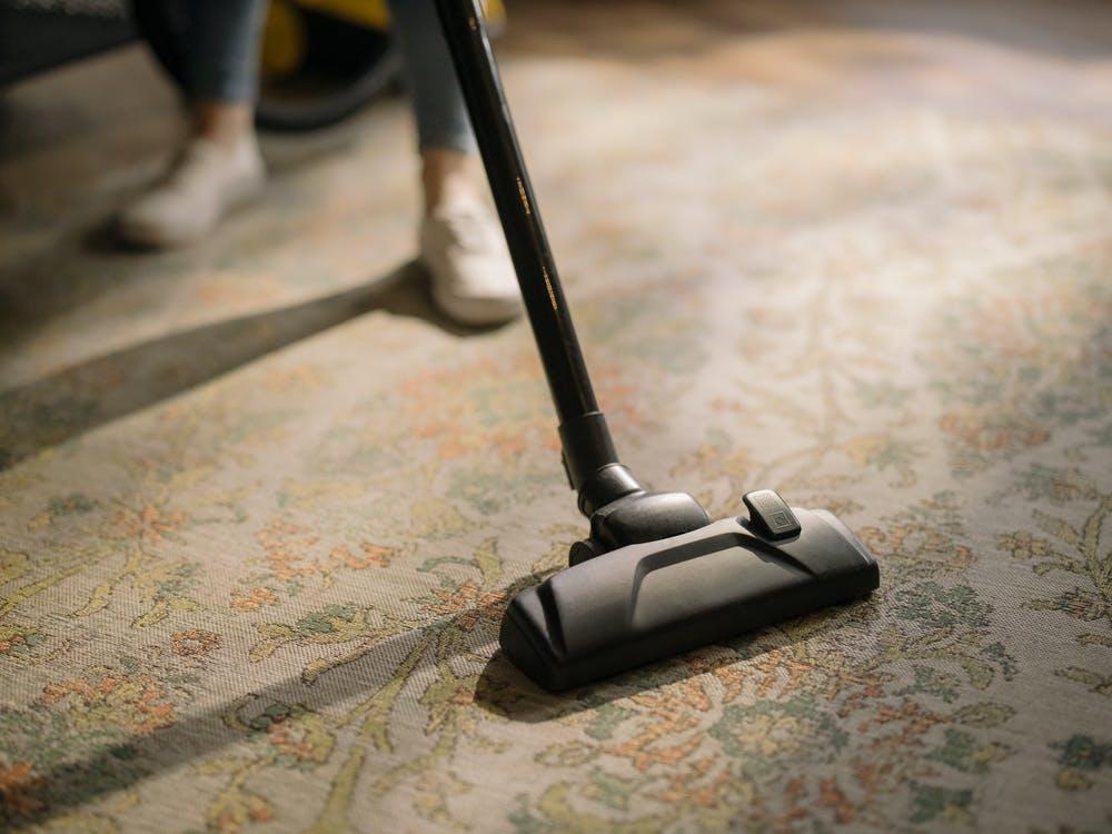 lightweight stick vacuum cleaner on carpet