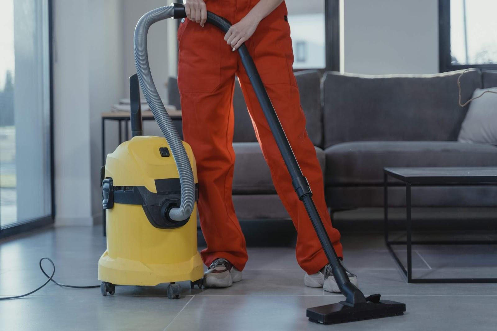 cleaner using vacuum in office