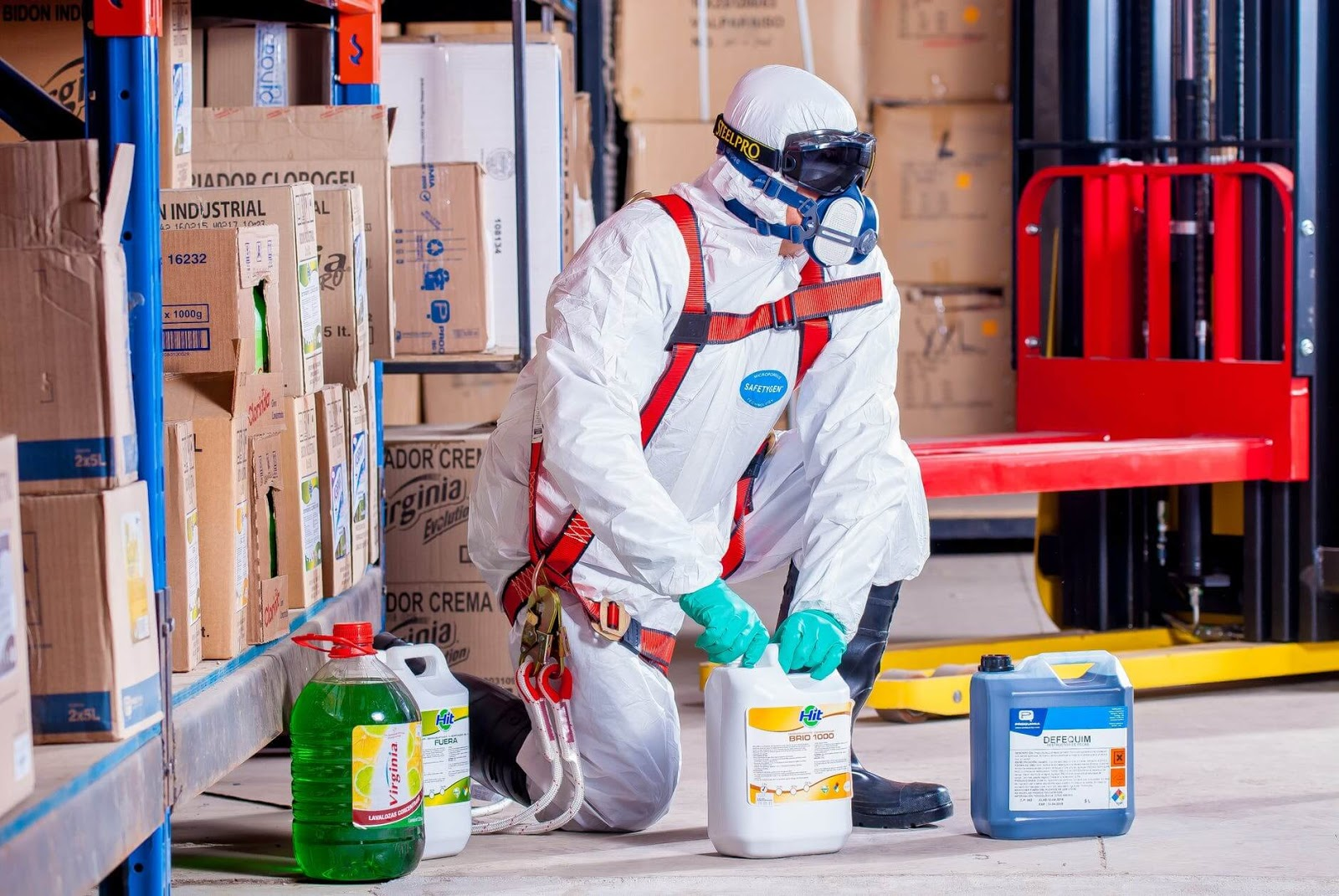 a person using chemicals to disinfect a warehouse