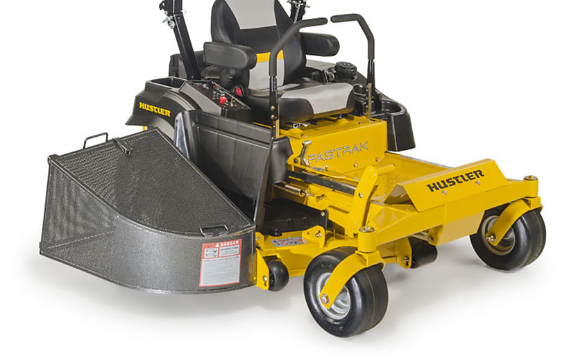 Image of front of a yellow mower with a black metal grass bagger mounted on the side