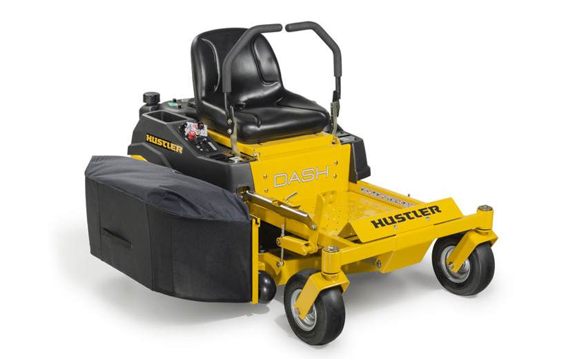 Image of yellow mower with grass bagger mounted to the side of the deck.