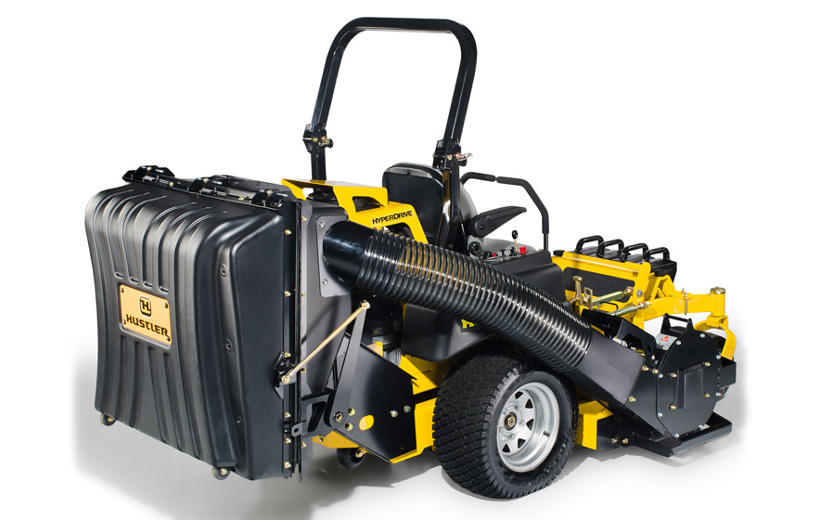 Image of the back of a mower with a black rectangular grass catcher mounted to the mower