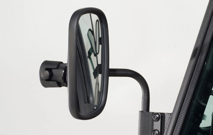 Image of a side mirror on a utility vehicle with a white background