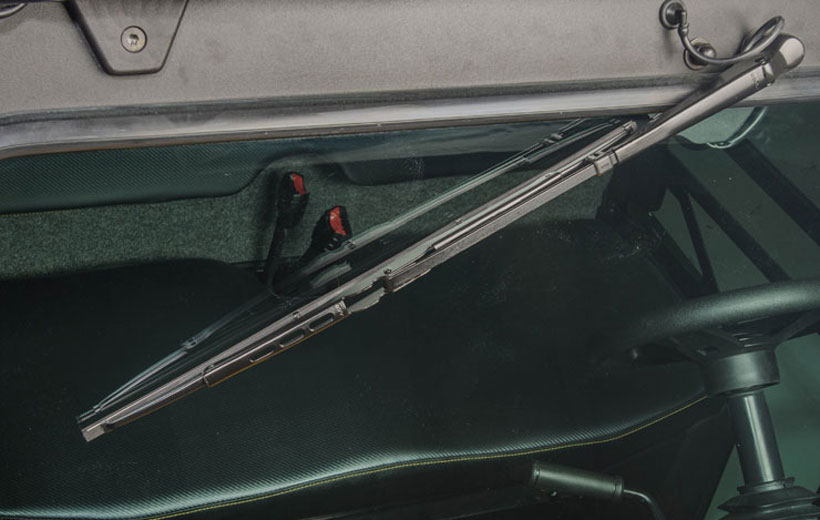 Image of a windshield wiper on a utility vehicle windshield.