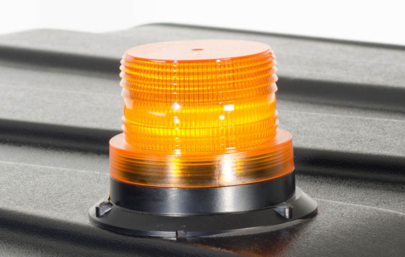 Image of an orange cylindrical light mounted on a utility vehicle roof.