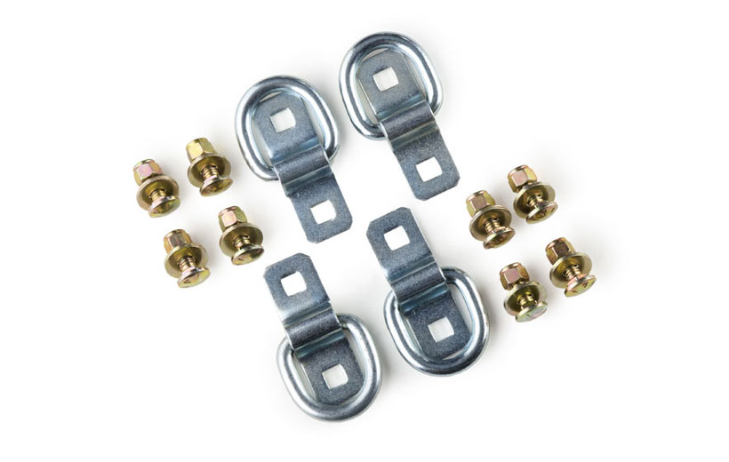 Image of the bolts and tie down pieces on a white background.