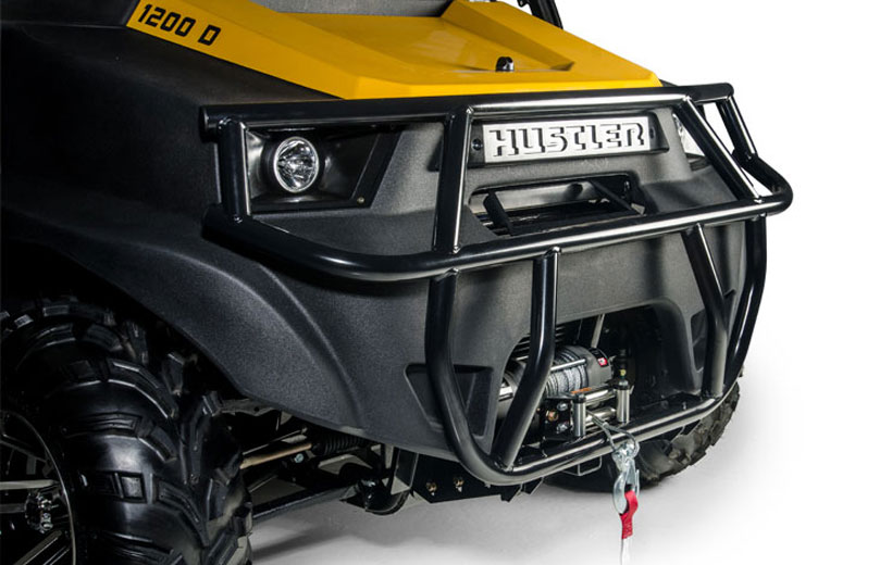 Image of the front of a utility vehicle showing the bars of a brush guard mounted to it.