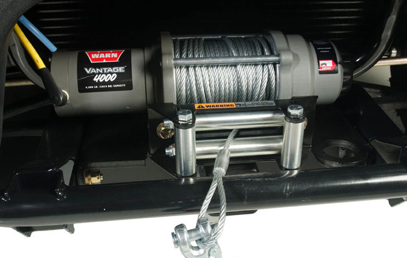 Image of a winch mounted to the front of a utility vehicle.