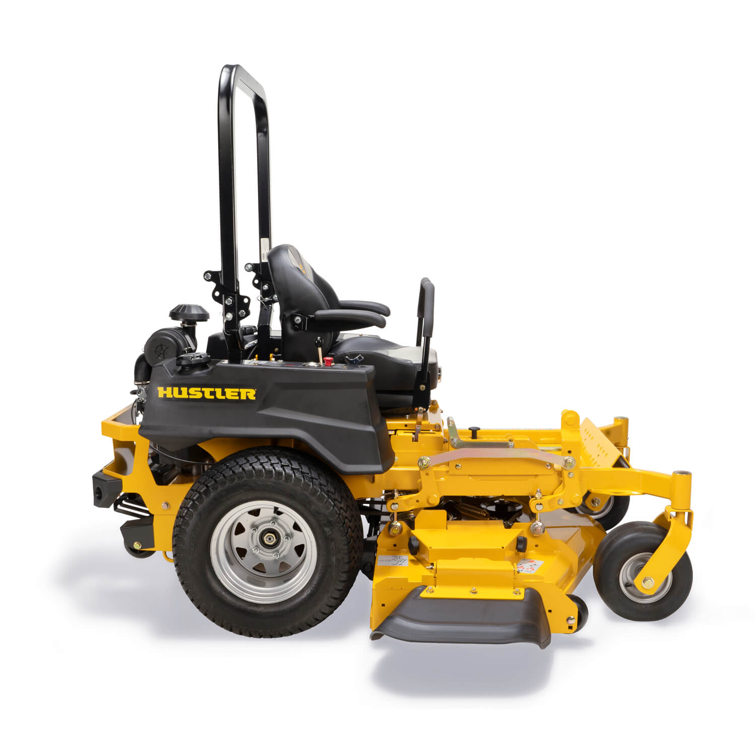 Image of the profile of a yellow zero-turn mower showing the discharge chute of the deck
