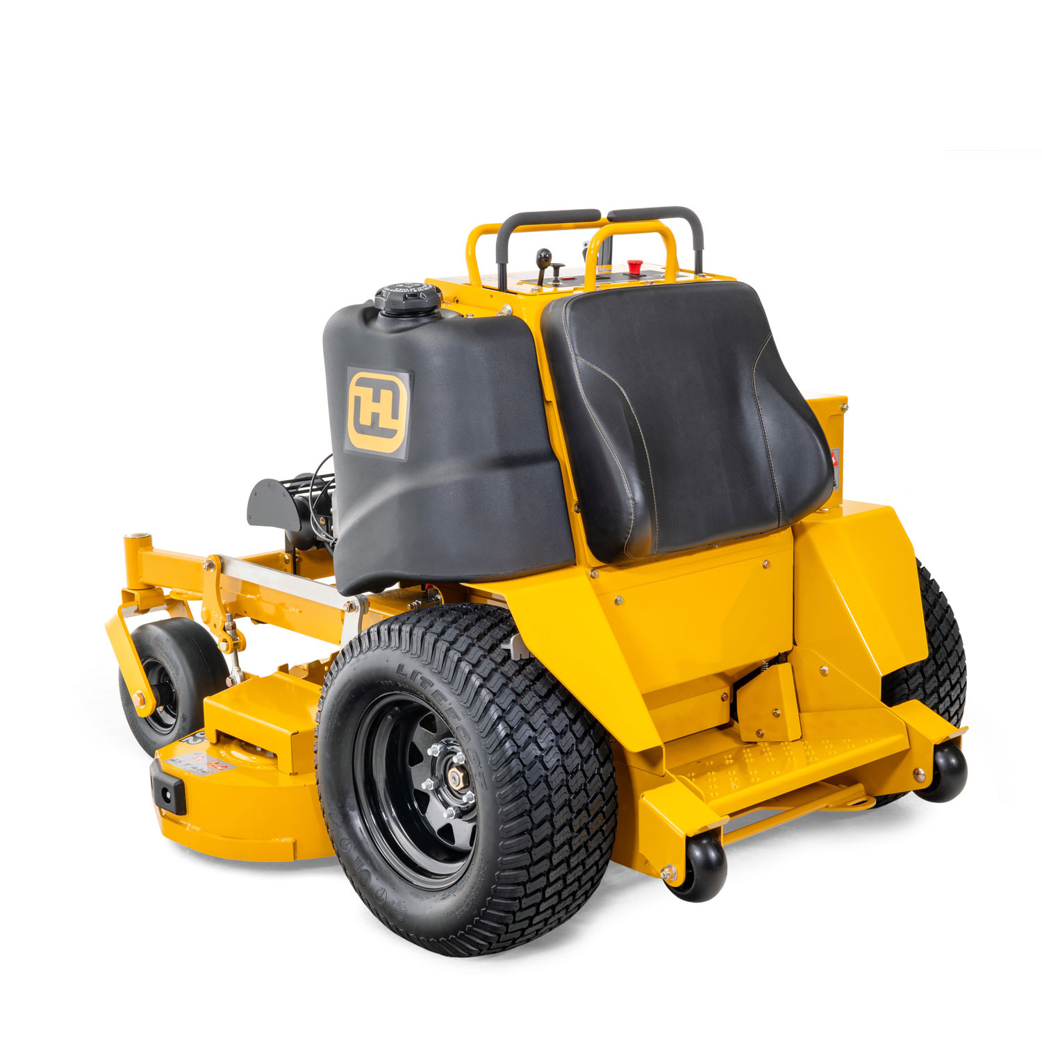 Image of the rear three quarters of a yellow stand-on mower showing the trim side of the deck