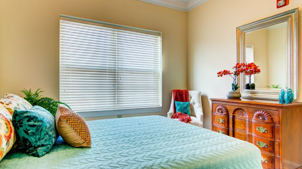West Falls Center Assistant Living Bedroom Image in Falcons Landing Life Plan Community