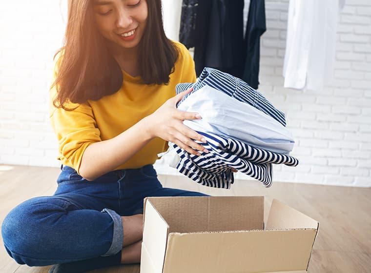 Packing belongings in box