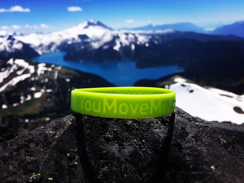 YouMoveMe band on top of mountain