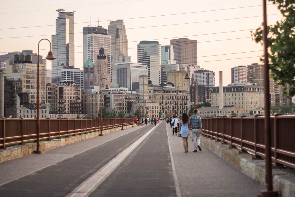 Stone arch bridge photo by Weston MacKinnon on Unsplash