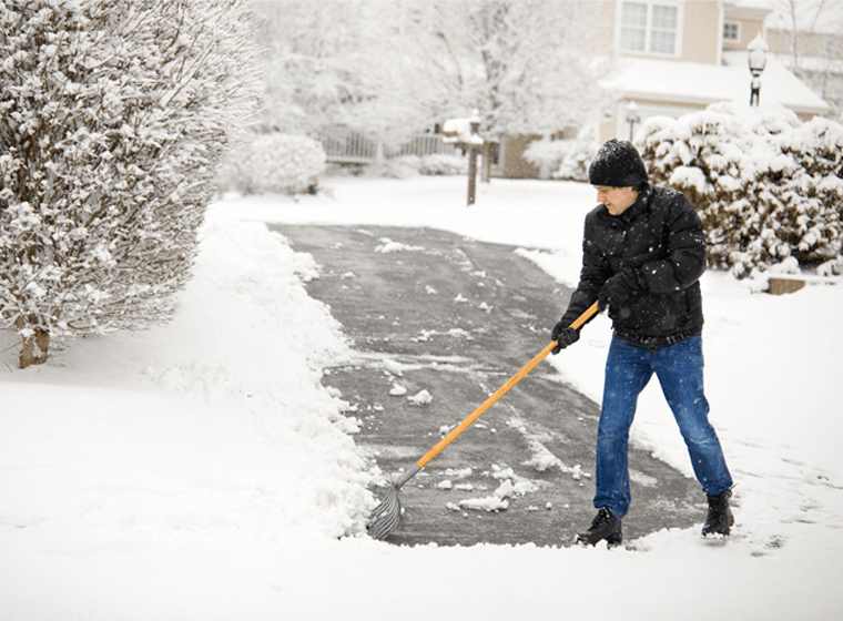 shoveling snow on driveway