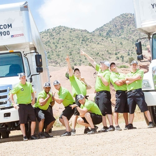 You Move Me team posing in front of truck