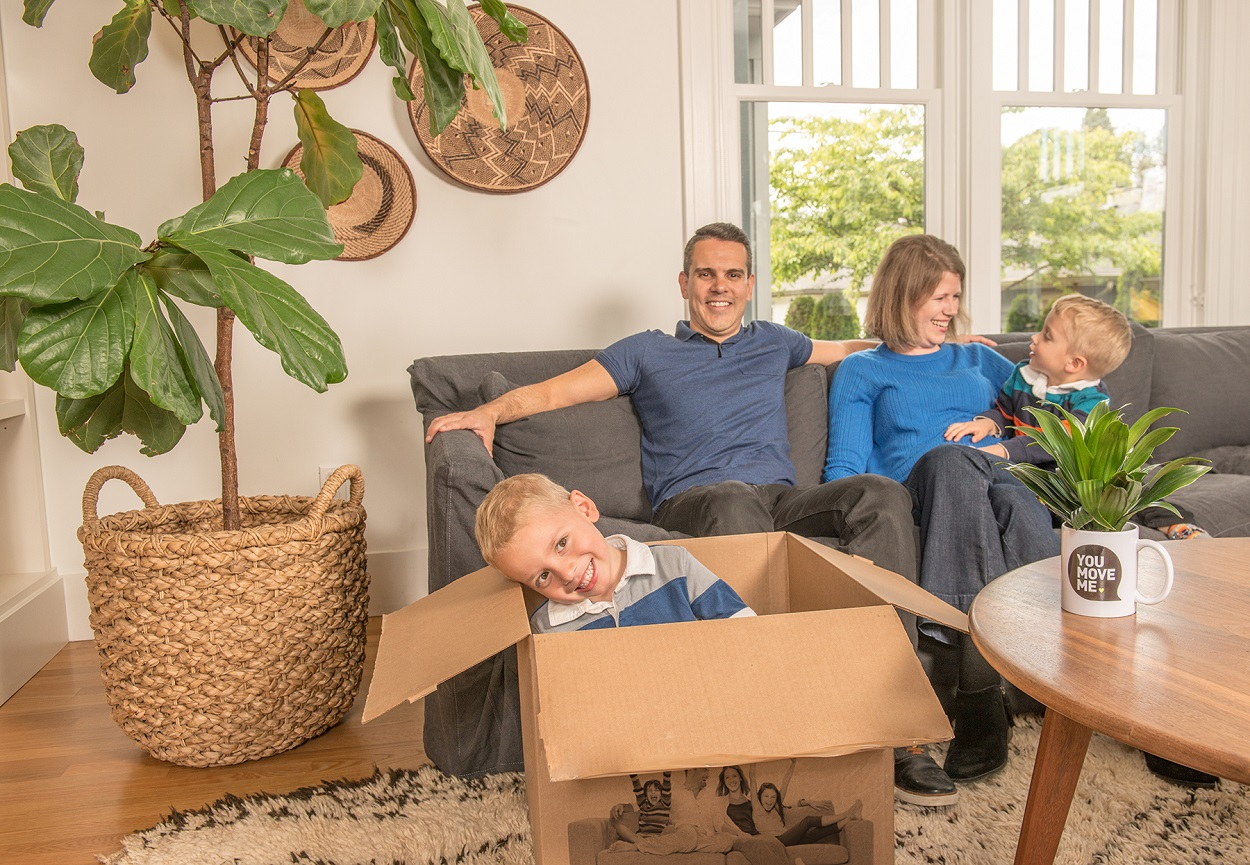 family with two kids getting ready for the move