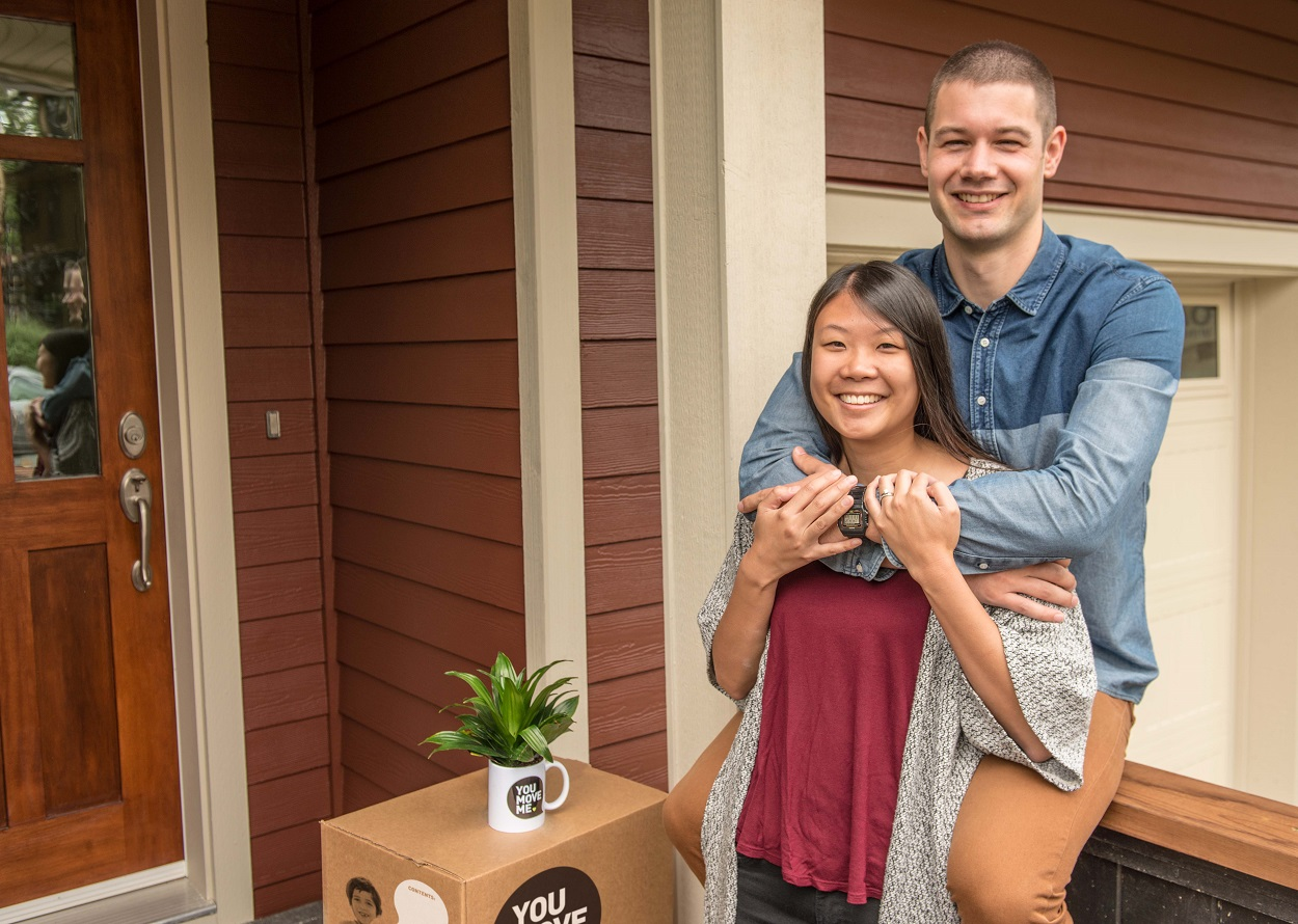 young family moving into a new home