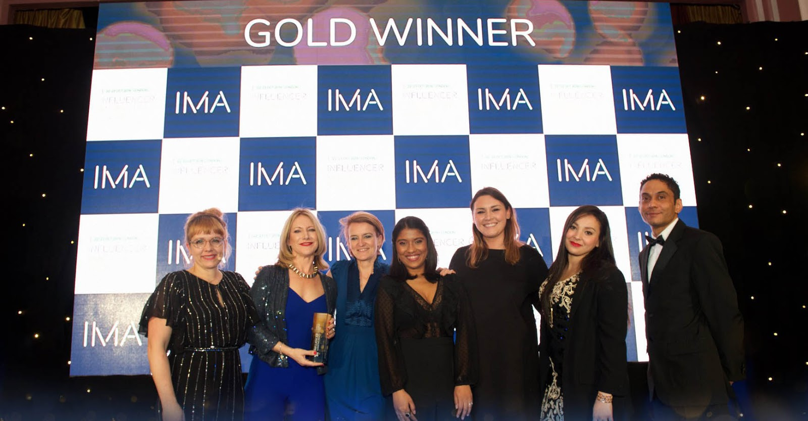 Traackr Team receiving Best Influencer Discovery & Best Campaign Planning & Management Awards at IMA19