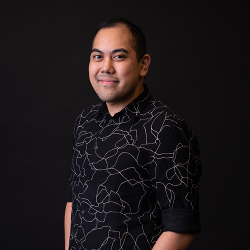 Headshot of Karl Delossantos, Director of Growth