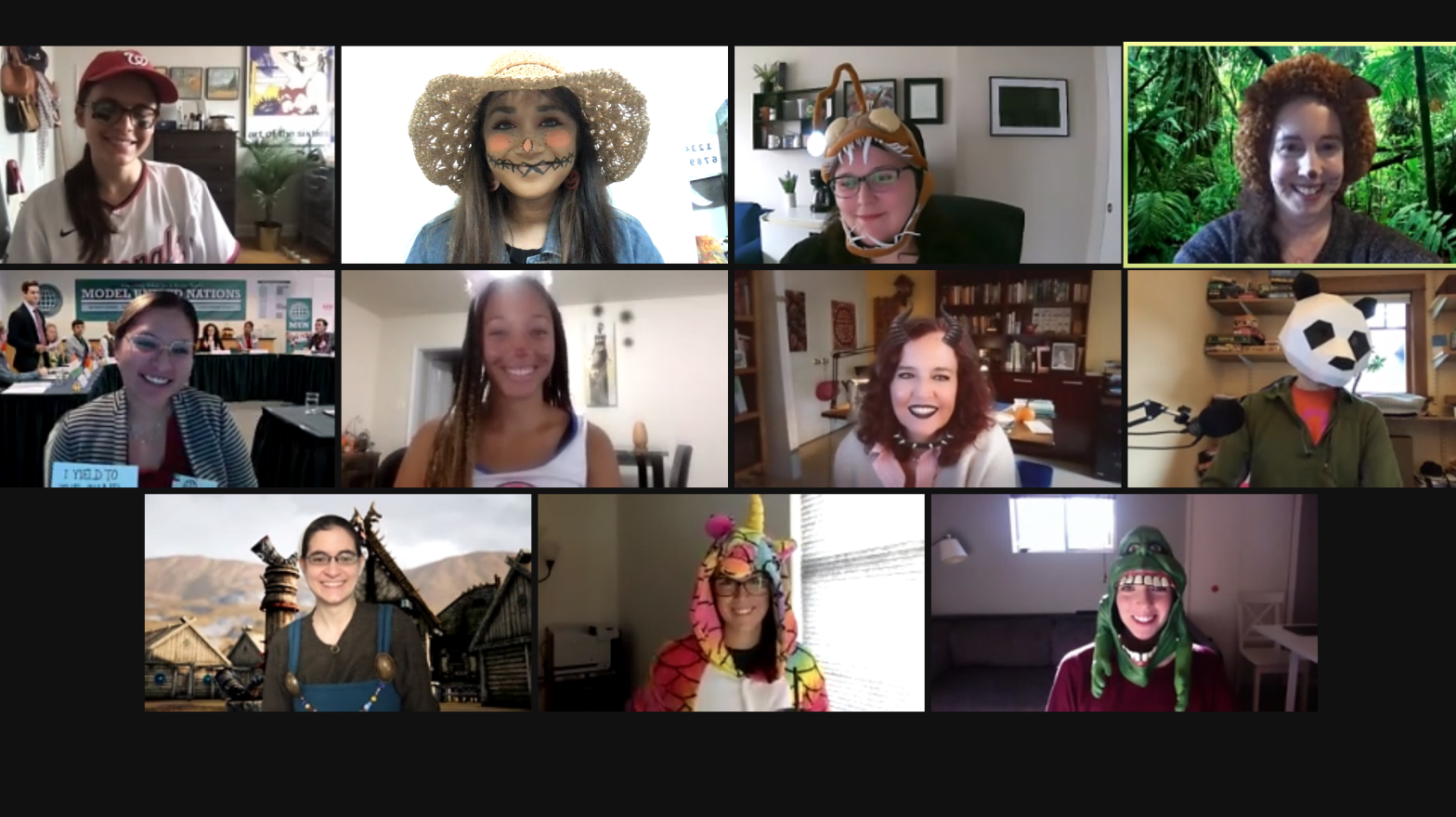 Axions demonstrating their Halloween spirit by wearing costumes on a Zoom call