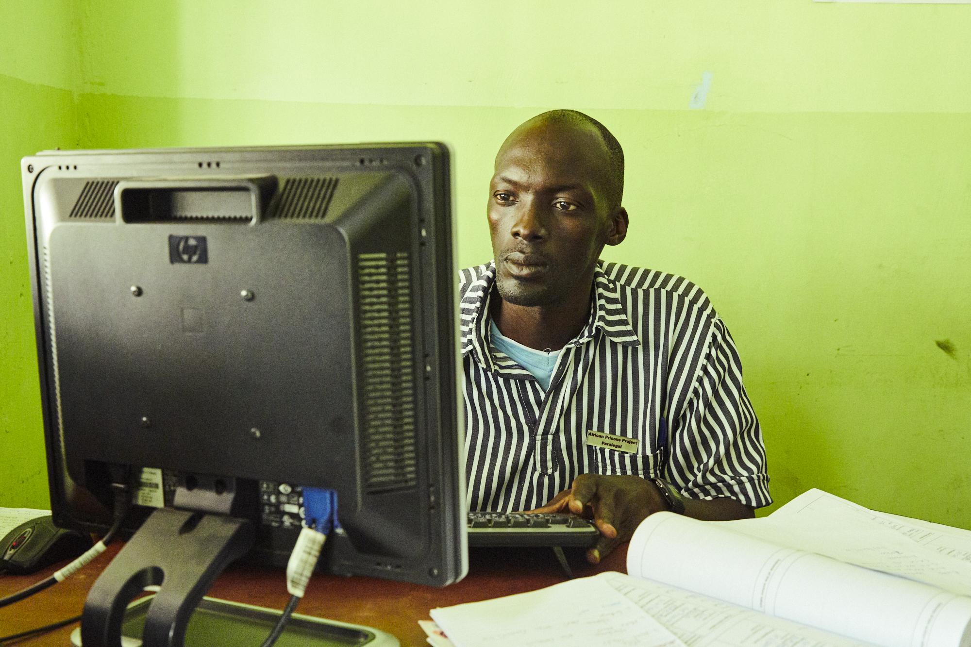 Justice Defenders Prisoner studying at desk