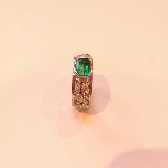 Emerald and tapered baguette diamond ring